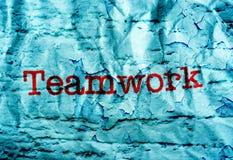 Texto del trabajo en equipo en fondo del grunge Foto de archivo