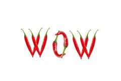 Texto del wow integrado por las pimientas de chile. Aislado en el fondo blanco Imagen de archivo libre de regalías