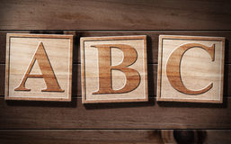 Texto do ABC 3D na madeira. Foto de Stock