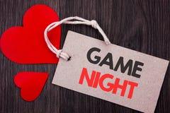 Texto do anúncio da escrita que mostra a noite do jogo Conceito do negócio para o evento do tempo do jogo do divertimento do entr imagens de stock
