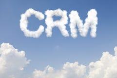 Texto do conceito de CRM nas nuvens Imagens de Stock Royalty Free