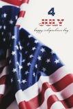 Texto 4 do Dia da Independência feliz de julho e das bandeiras dos E.U. Imagem de Stock