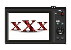 Texto do vermelho xxx na tela do fundo da câmara digital Fotos de Stock