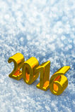 Texto dourado do Natal do ano 2016 novo na neve Fotografia de Stock Royalty Free