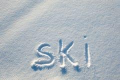 Texto escrito en nieve. Imágenes de archivo libres de regalías