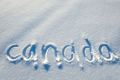 Texto escrito en nieve. Fotos de archivo libres de regalías