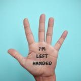 Texto eu sou canhoto na palma da mão imagens de stock