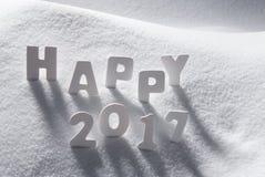 Texto 2017 feliz com letras brancas na neve Imagem de Stock Royalty Free