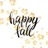 Texto feliz de la caída con las hojas de otoño anaranjadas Foto de archivo libre de regalías