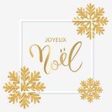 Texto francês Joyeux Noel com rotulação da mão Backgroun do Natal Foto de Stock Royalty Free