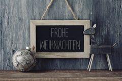 Texto Frohe Weihnachten, Feliz Navidad en alemán Fotografía de archivo libre de regalías