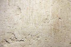 Texto grego antigo histórico antigo e velho em Clay Tablets f imagem de stock