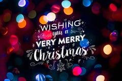 Texto lindo del garabato de la falta de definición del bokeh de la tarjeta de la Feliz Navidad Fotografía de archivo libre de regalías