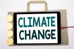 Texto manuscrito que muestra el cambio de clima Escritura del concepto del negocio para calentarse global del planeta escrito en  Imagen de archivo libre de regalías
