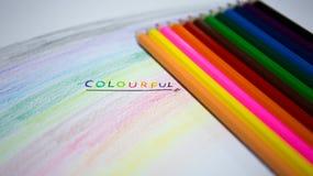 Texto no papel com lápis da cor Foto de Stock Royalty Free