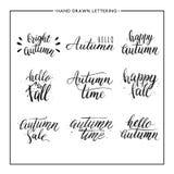 Texto pintado a mano - otoño feliz, hola caída, venta Imagen de archivo