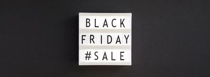 Texto preto da venda de sexta-feira no lightbox branco foto de stock royalty free
