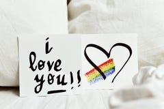 Texto te amo en una nota Imagenes de archivo