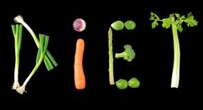 Texto vegetal de la dieta en fondo negro Foto de archivo
