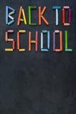 Texto & x22; De volta ao school& x22; criado com as cores pastel do óleo na ardósia Foto de Stock Royalty Free