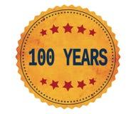 Texto 100-YEARS, en sello de la etiqueta engomada del amarillo del vintage Fotografía de archivo