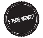Texto 5-YEARS-WARRANTY, en sello negro de la etiqueta engomada Fotografía de archivo libre de regalías