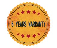 Texto 5-YEARS-WARRANTY, no selo da etiqueta do amarelo do vintage Fotografia de Stock Royalty Free