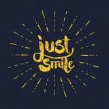 Textos de la sonrisa del amarillo apenas con los rayos en gris Fotos de archivo libres de regalías