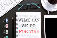 Textotez ce qui peut nous faire pour vous sur le fond de livre blanc/concept d'affaires Photo libre de droits