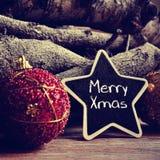 Textotez joyeux Noël dans un tableau noir en forme d'étoile, filtré Photographie stock