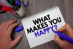 Textotez l'apparence de signe ce qui te fait la question heureuse Le bonheur conceptuel de photo vient avec l'amour et la prise p Images stock
