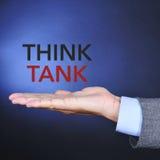 Textotez le groupe de réflexion dans la main d'un homme Photographie stock libre de droits