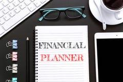 Textotez le planificateur financier sur le fond de livre blanc/concept d'affaires Photos libres de droits