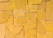 Textrue żółta kamienna ściana zdjęcia stock
