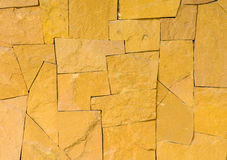 Textrue of yellow stone wall. Texture of yellow stone wall for background Stock Photos