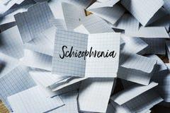 Textschizofreni i ett stycke av papper arkivfoto