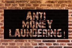 Texttecken som visar anti-penningtvätt Skrivande in projekt för begreppsmässigt foto som får bort smutsiga pengar och som gör den arkivbilder
