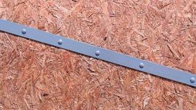 Textur av brädet av pressat ut sågspån med lim OSB arkivfoto
