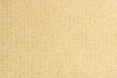 Textur av brun papp, vertikala band, abstrakt bakgrund Arkivfoto