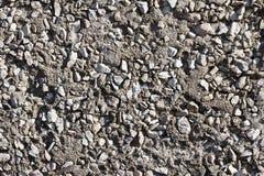 Textur av cement med grus Arkivbild