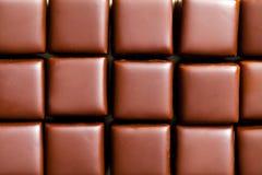 Textur av chokladbrända mandlar Arkivfoto