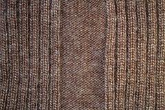 Textur av den bruna ärmlös tröja Arkivfoto