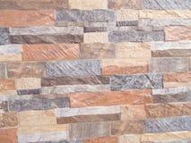 textur av den bruna stenväggen Arkivfoto