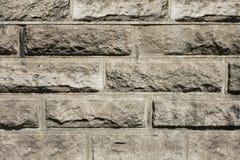 Textur av den bruna strukturen för bakgrund för stenvägg Arkivfoton