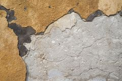 Textur av den förfallna väggen av huset Royaltyfria Bilder