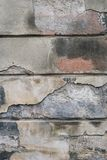 Textur av den förfallna väggen av huset Arkivfoton