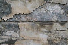 Textur av den förfallna väggen av huset Arkivbild