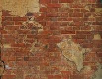 Textur av den gamla tegelstenväggen på gatan Royaltyfria Foton