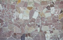 Textur av den gammala rockväggen för bakgrund Fotografering för Bildbyråer