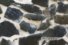 Textur av den gammala rockv?ggen f?r bakgrund royaltyfri bild